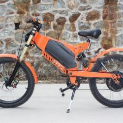 Электровелосипед оранжевый бомбардировщик